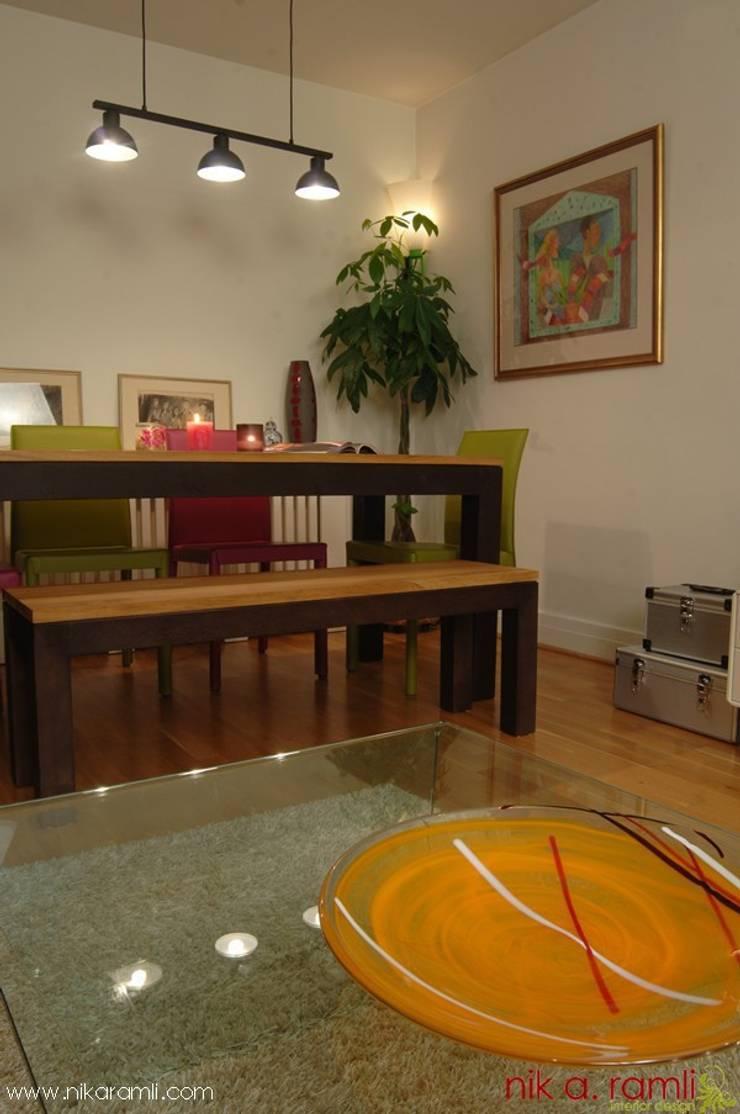 Colours Of Love:  Living room by Nik A Ramli Interior Design