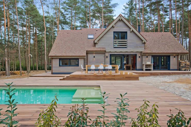 Maison ossature bois: Maisons de style  par blackStones