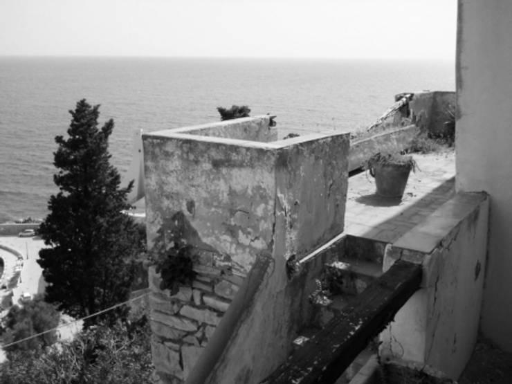casa dentro le mura_ante operam: Case in stile  di laboratorio di architettura - gianfranco mangiarotti