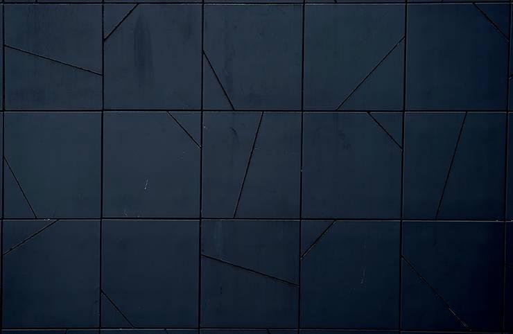 Black Hotel_tiles: Hotel in stile  di laboratorio di architettura - gianfranco mangiarotti, Minimalista