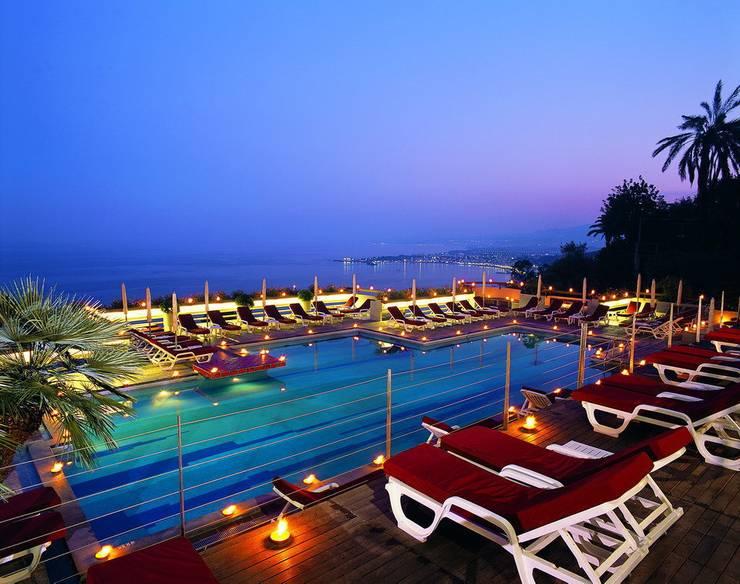 Hotel Monte Tauro: Hotel in stile  di laboratorio di architettura - gianfranco mangiarotti