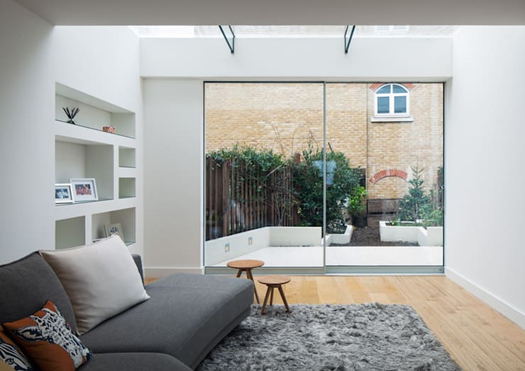 Living room by Poulsom Middlehurst Ltd.