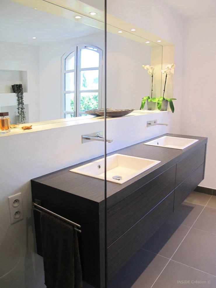 Salle de bain en béton ciré: Salle de bains de style  par INSIDE Création