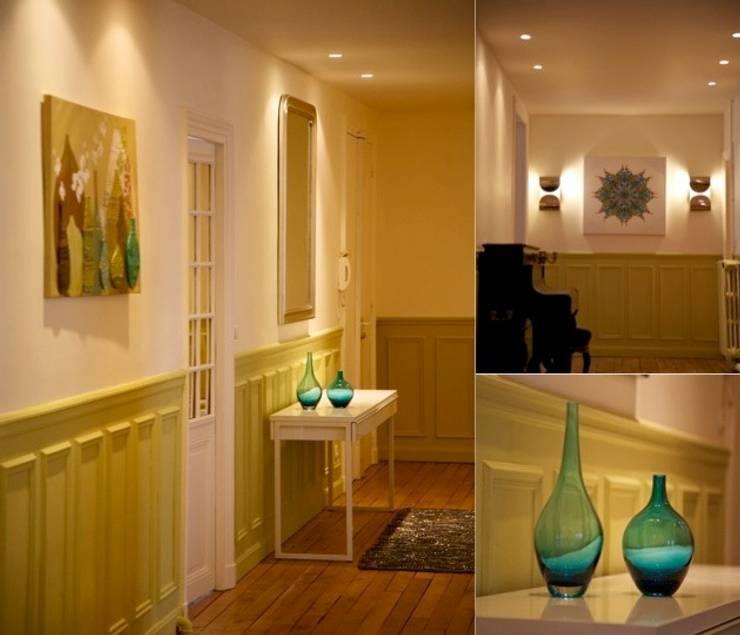 Entrée appartement haussmannien: Couloir et hall d'entrée de style  par PATRICIA FRANCOIS