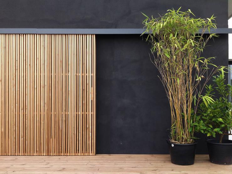 Façade: Maisons de style  par BIENSÜR Architecture
