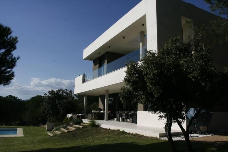 Casa en Galapagar: Casas de estilo  de Lauffer-Iza arquitectos