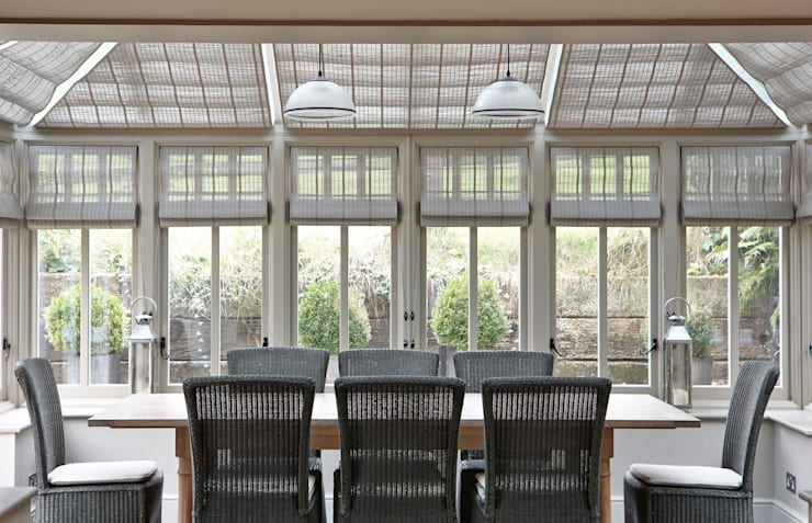 Country Home Conservatory:  Dining room by Charlotte Crosland Interiors