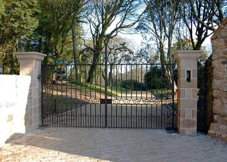 Estate Entrance Gates:   by Unique Iron Design Ltd.