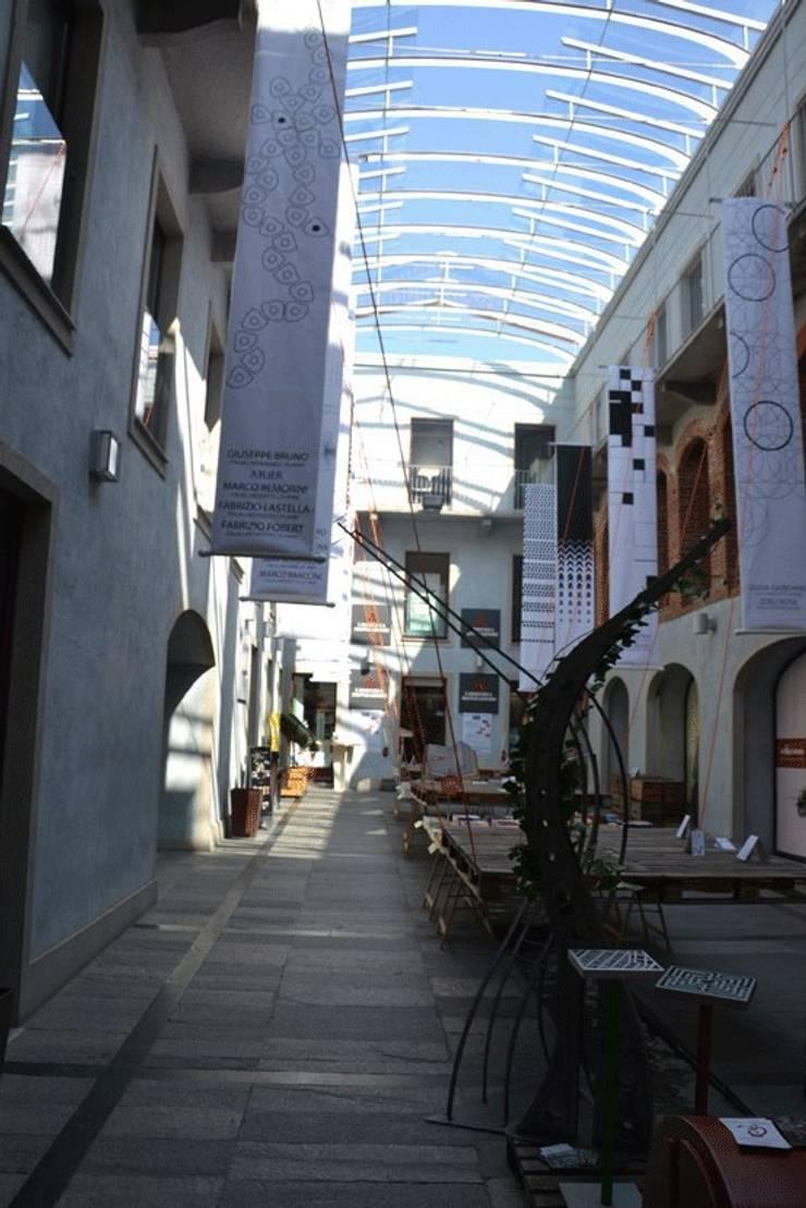 Presso mostra Senza Paragoni 2012: Giardino in stile  di Marco Braccini Architetto,