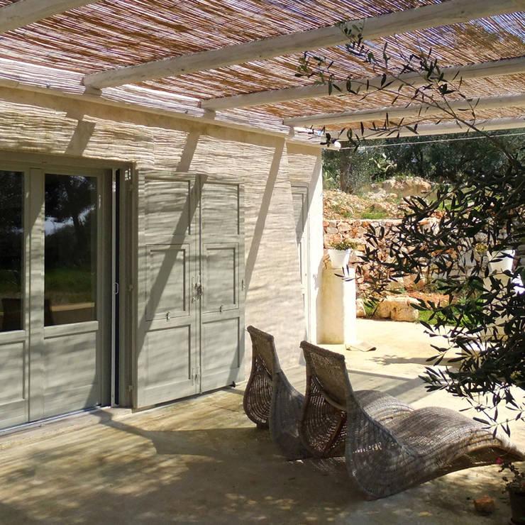 casa GM: Terrazza in stile  di 0-co2 architettura sostenibile