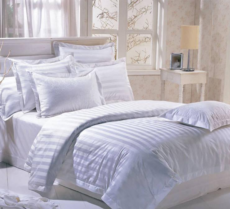 Ropa de baño y de cama: Dormitorios de estilo  de Fabrica de Textiles de Canarios