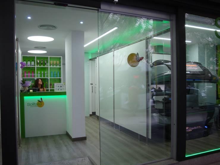 SOLITALIA: Espacios comerciales de estilo  de INTRADE CONSULTING S.L.