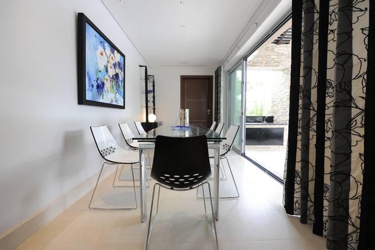 Quinta do Lago:  Dining room by Cheryl Tarbuck Design