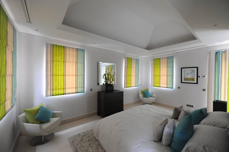 Quinta do Lago:  Bedroom by Cheryl Tarbuck Design