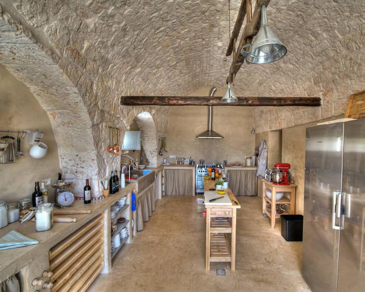 Il Gelso Bianco: Giardino in stile  di Architetto Floriana Errico,