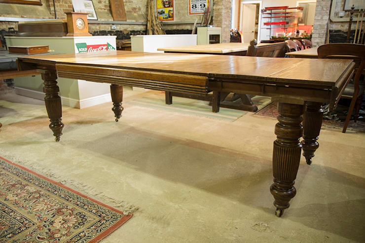 Antique extending oak dining table:  Dining room by Brown's Antiques Billiards and Interiors