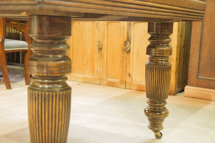 Antique extending oak dining table.:  Dining room by Brown's Antiques Billiards and Interiors