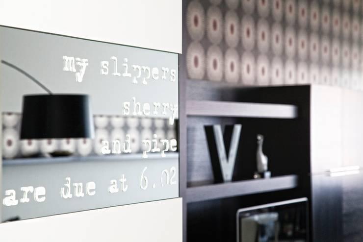 Particolare ingresso: Soggiorno in stile  di MNA Studio | Macchi Nicastri Architetti