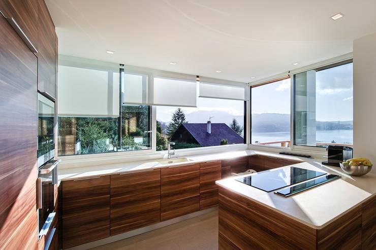 Maison M: Maisons de style  par Atelier Rémy Giffon