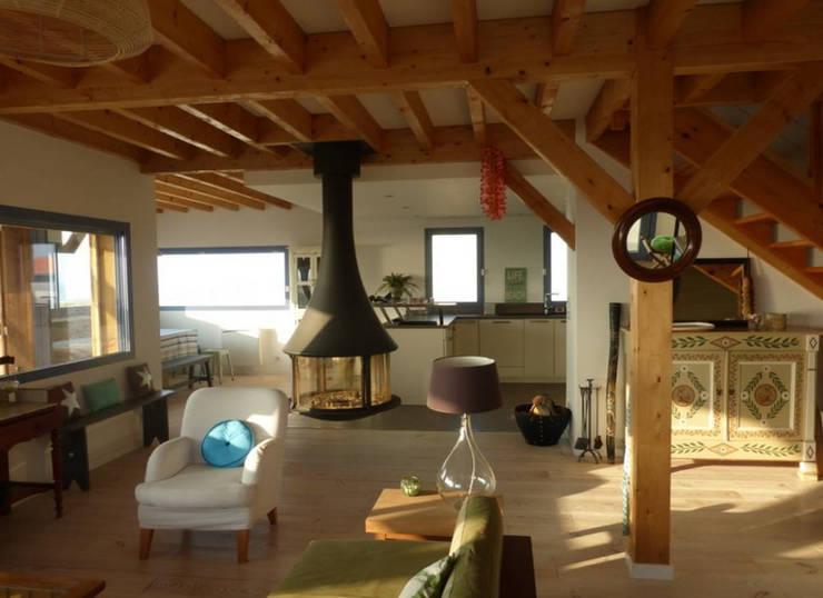 Face a l'Ocean: Maison de style  par EURL Cyril DULAU architecte