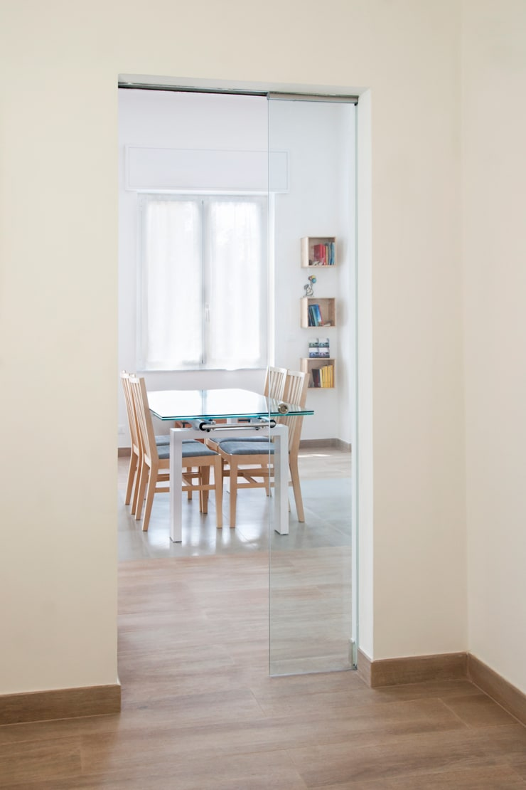 CASA AP: Sala da pranzo in stile  di Andrea Orioli
