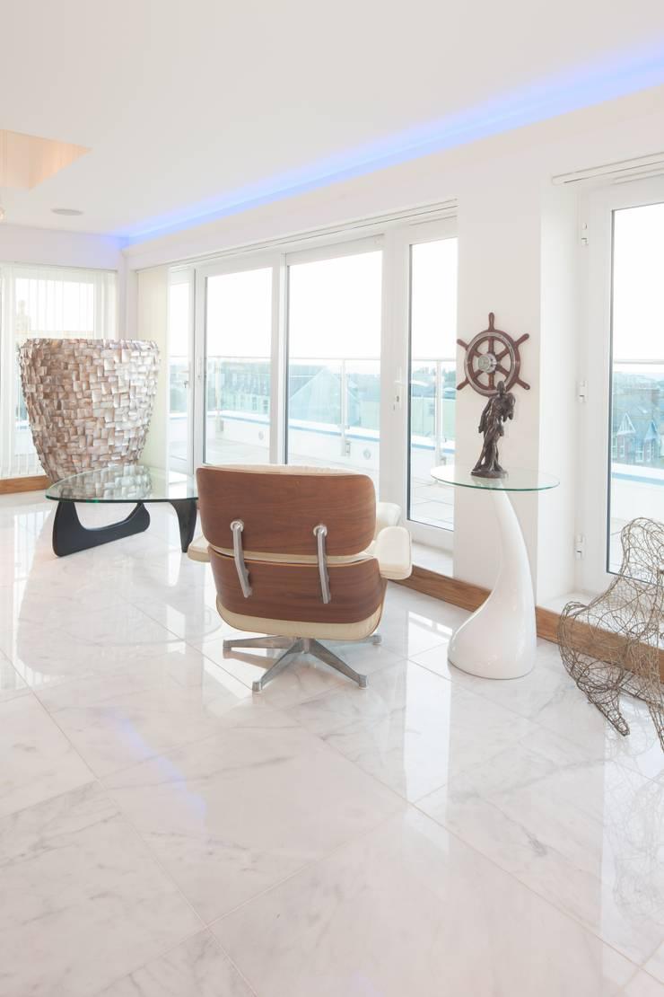 Coastal Penthouse:  Living room by Yorkshire Design Associates