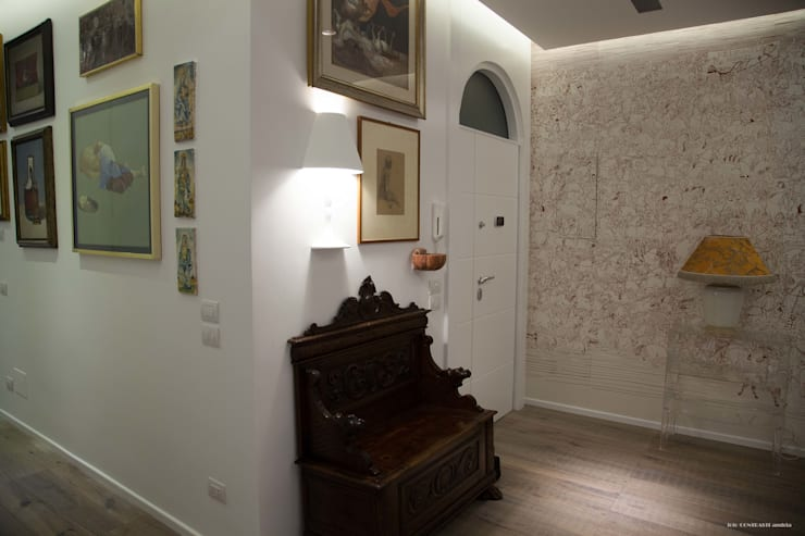 ingresso: Ingresso & Corridoio in stile  di G/G associati studio di ingegneria e architettura _ing.r.guglielmi_arch.a.grossi