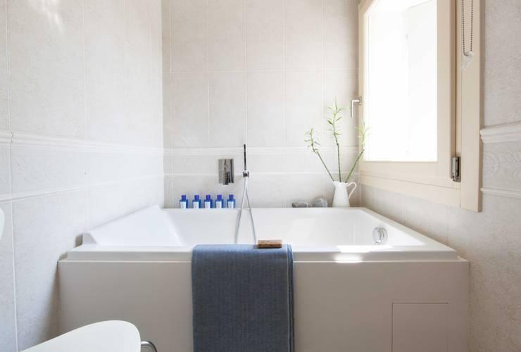 Casas de banho  por Didonè Comacchio Architects