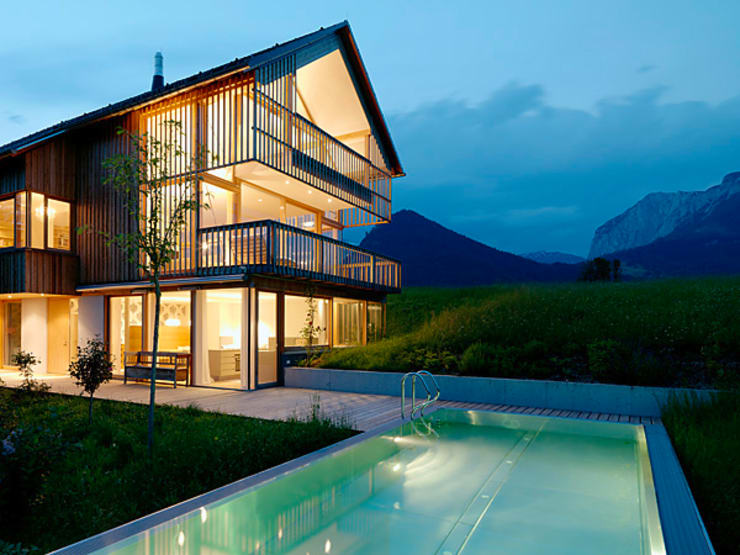 Privathaus mit Holzfenstern:  Fenster von KAPO Fenster und Türen GmbH