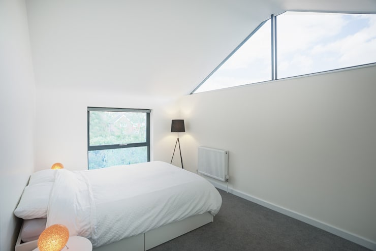 The Cedar Lodges:  Bedroom by Adam Knibb Architects