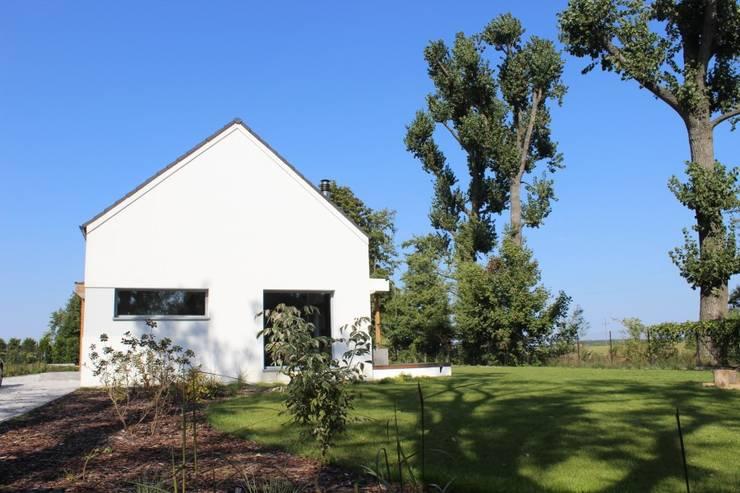 Dom w Rybojedzku : styl , w kategorii Domy zaprojektowany przez Piechnik Architekci