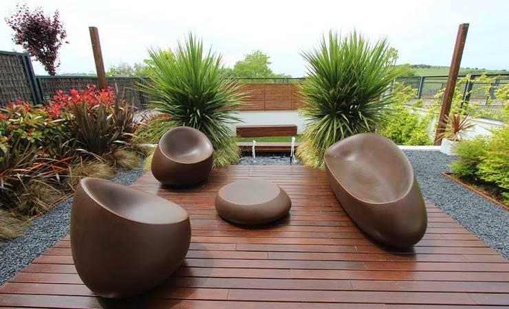 Sofas coleccion Stone: Balcones y terrazas de estilo  de Decoracion Beltran