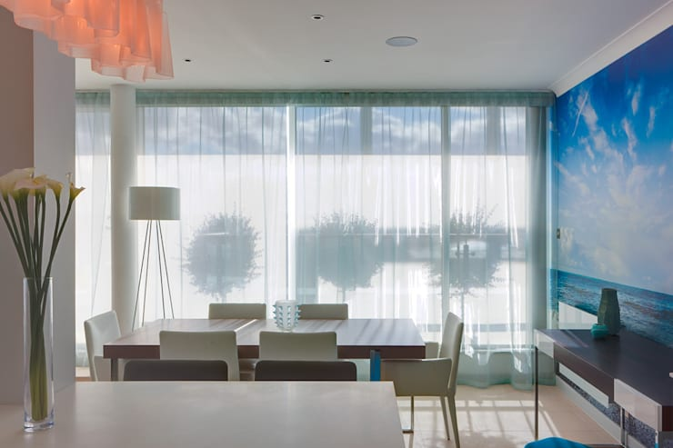 London Docklands penthouse :  Dining room by At Home Interior Design Consultants Cambridge