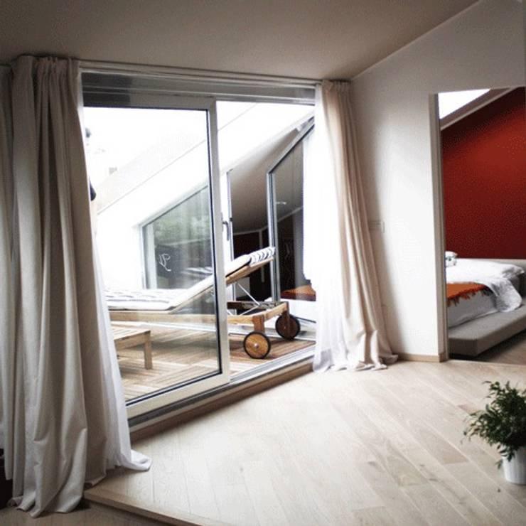 Roof Attic: Case in stile  di Principioattivo Architecture Group Srl
