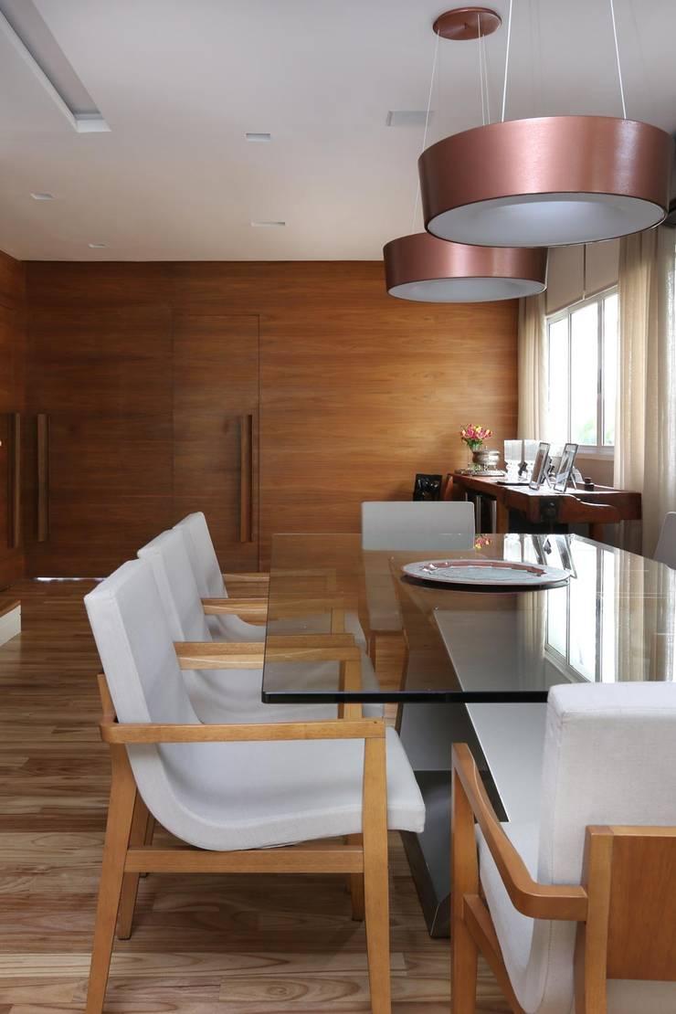 Cidade Jardim | Residenciais: Salas de jantar  por SESSO & DALANEZI