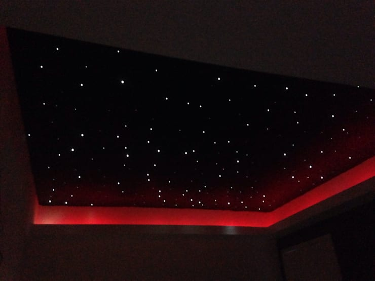 Starlight ceiling in 'movie room':  Living room by Lancashire design ceilings