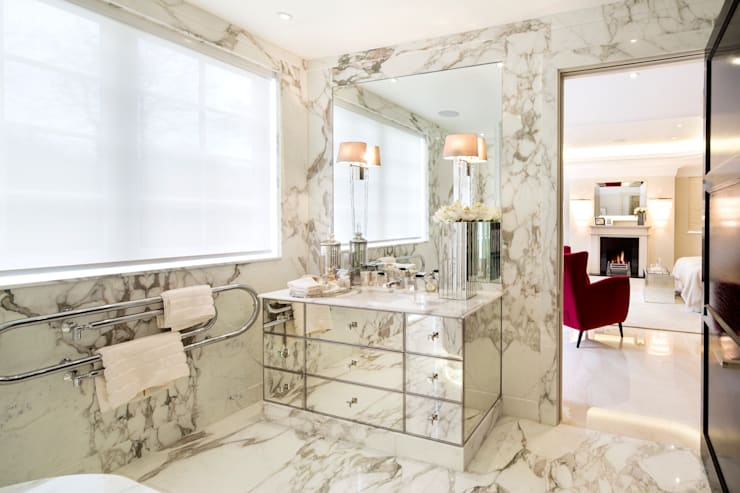 Baños de estilo  por Celia Sawyer Luxury Interiors