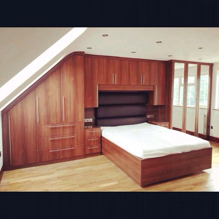 Loft wardrobes :  Bedroom by Smiths fitted wardrobes Ltd