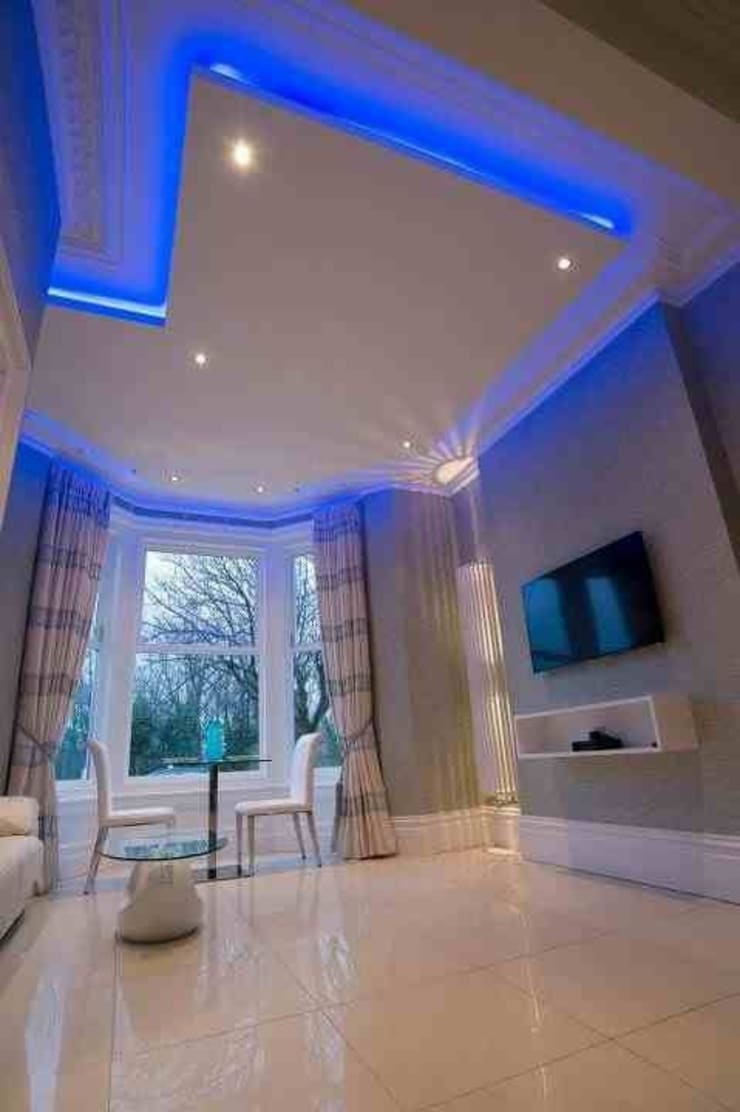 Breck apartments:  Living room by Lancashire design ceilings