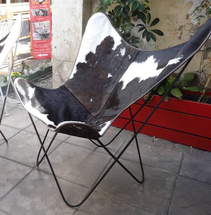 Sillas: Livings de estilo moderno por TAYLOR DECORACIONES