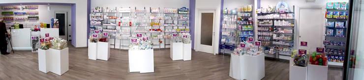Farmacia Vespolate: Negozi & Locali commerciali in stile  di NOMADE ARCHITETTURA E INTERIOR DESIGN