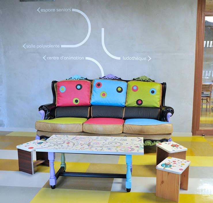 Aménagement d'espace à la ludothèque: Salon de style  par ATELIER D'éco SOLIDAIRE