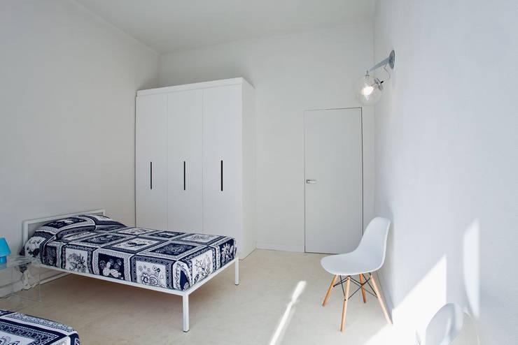 Chambre de style de style Minimaliste par PAOLO FRELLO & PARTNERS