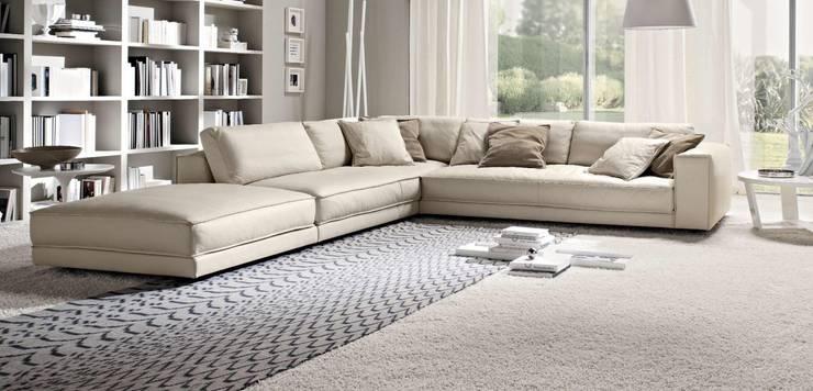 21 salas com sof s de canto para te inspirar a decorar a sua for Modelos sillones para living modernos