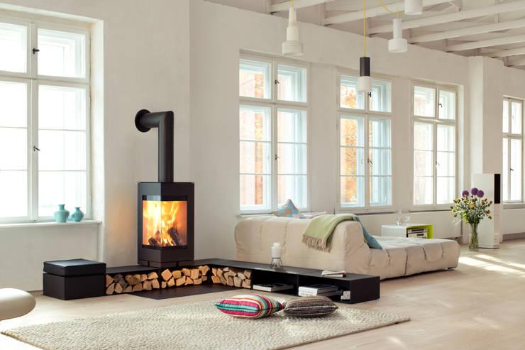 Projekty,  Salon zaprojektowane przez Kachelofen & kamin