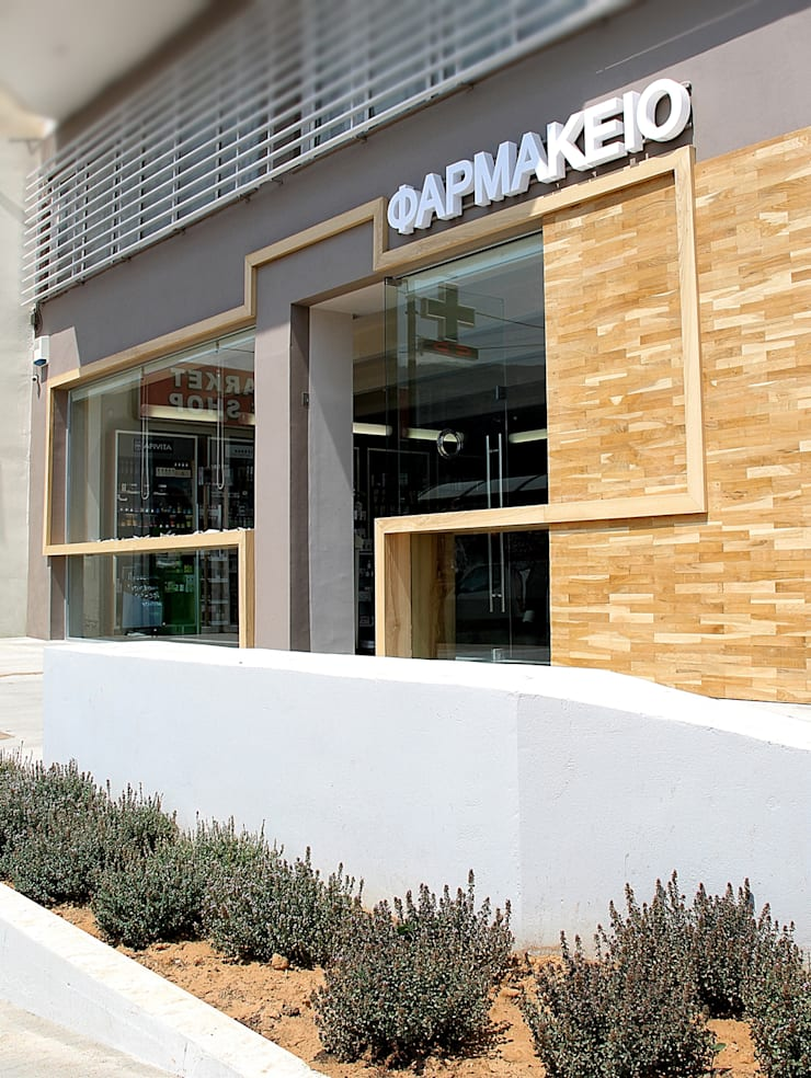 PHARMACY IN CRETE: Spazi commerciali in stile  di FPAA / Fiori Pietrapiana Architetti Associati