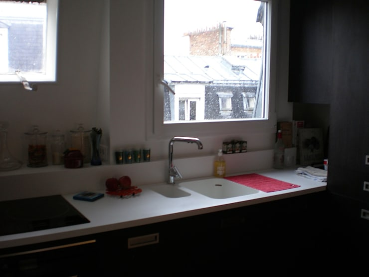 Appartement de 60m2, 18ème:  de style  par Philippe Demougeot