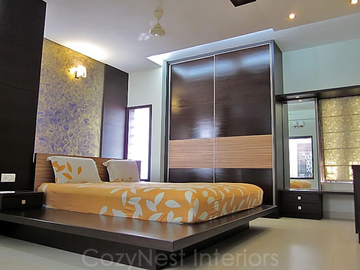Chinta Residence:  Bedroom by Cozy Nest Interiors