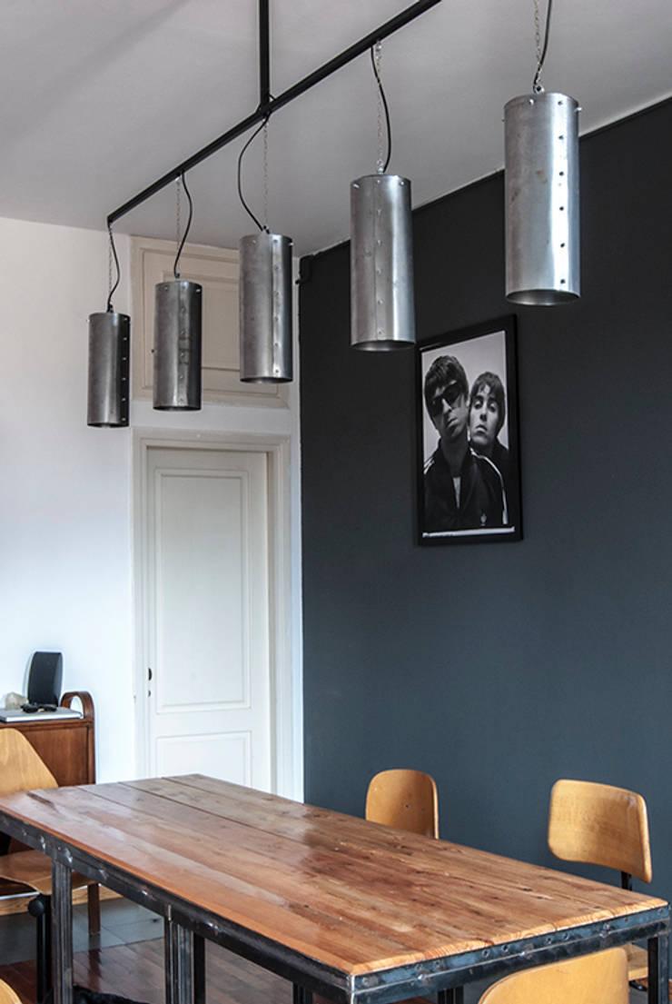 PRIVATE HOUSE, Milano: Paesaggio d'interni in stile  di UNCUT,