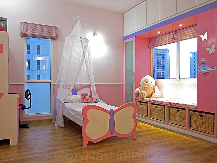 Jha Residence:  Nursery/kid's room by Cozy Nest Interiors